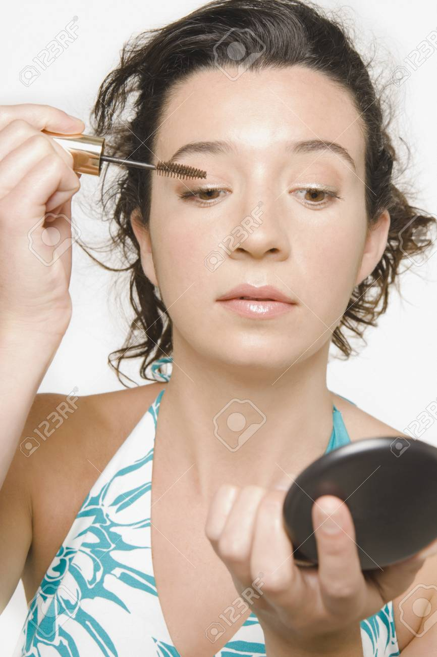 Young woman applying makeup Stock Photo - 16073585