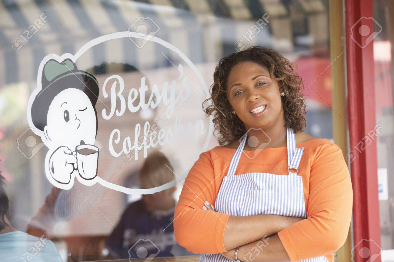 Portrait of woman in front of coffee shop Stock Photo - 16073635