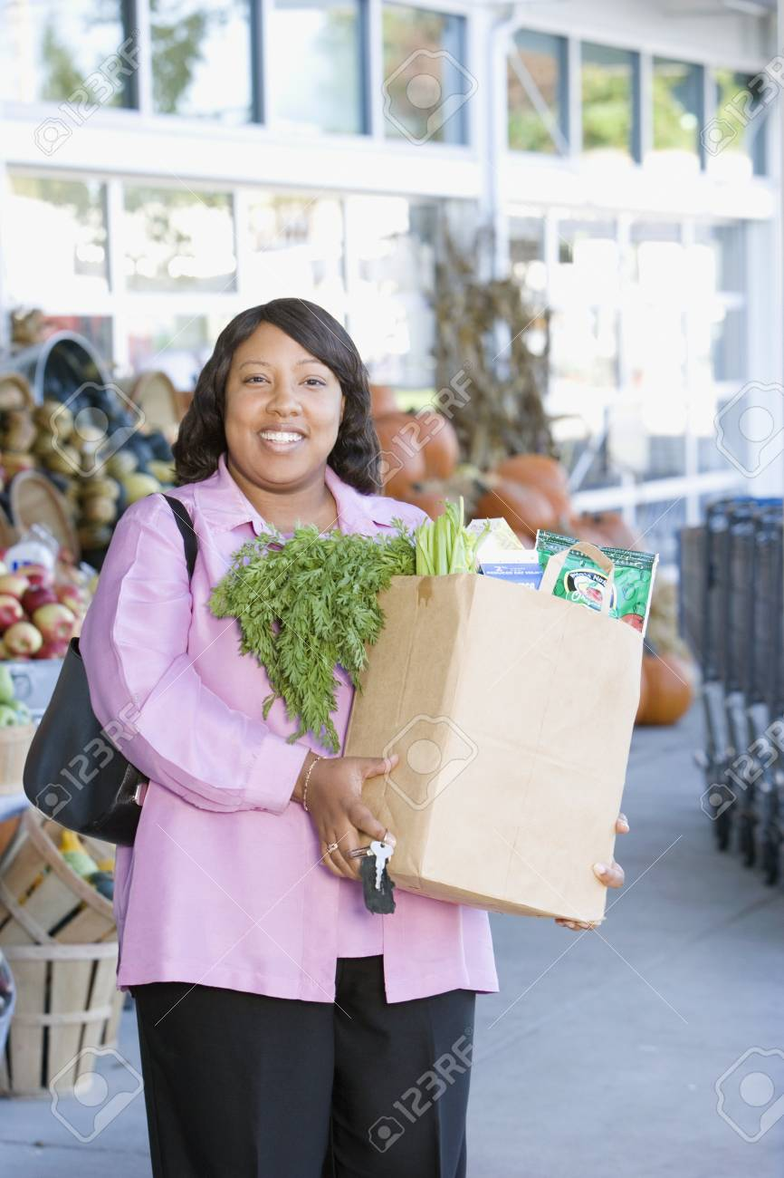Woman with bag of groceries outside grocery store Stock Photo - 16073718