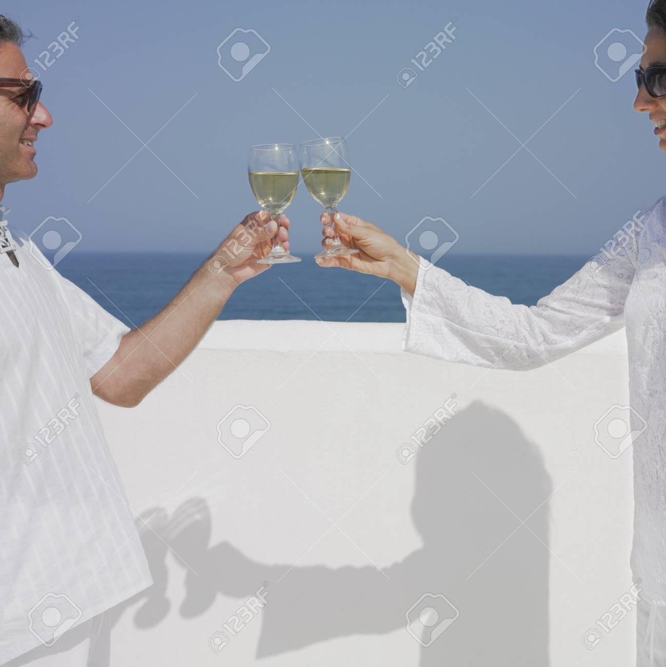 Couple toasting wine glasses Stock Photo - 16073753