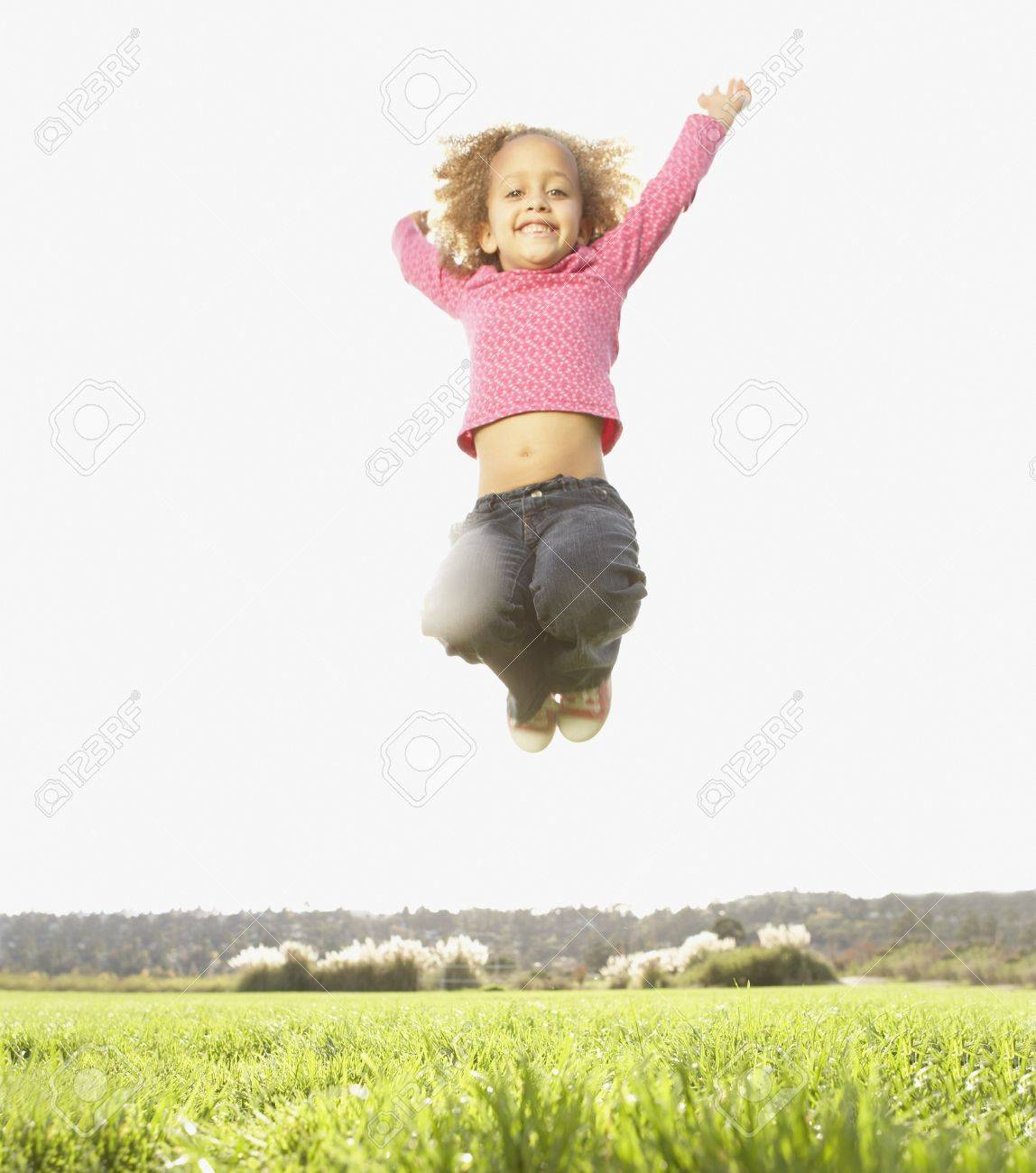 Portrait of girl jumping Stock Photo - 16073878