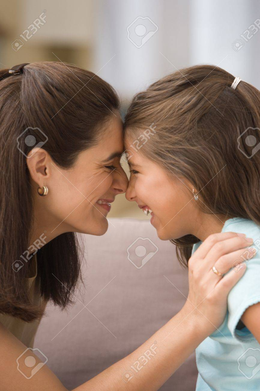 Profile of mother and daughter touching noses Stock Photo - 16074046