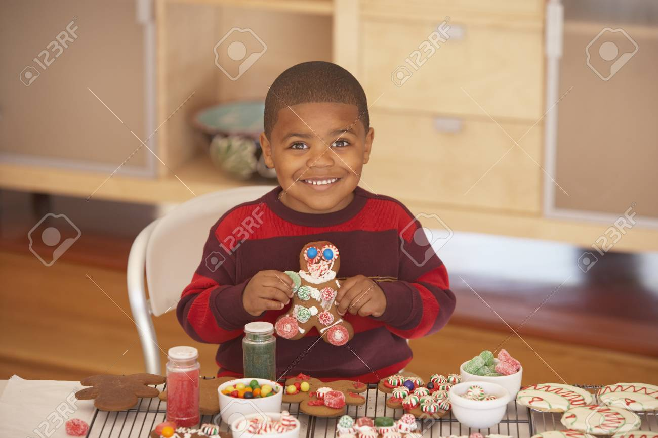 Young boy making gingerbread men Stock Photo - 16074191