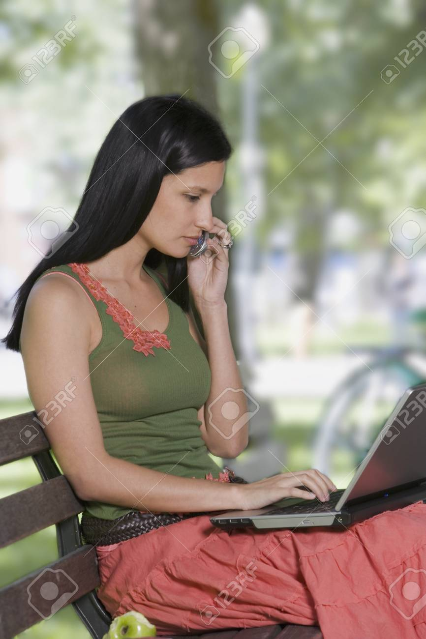 Young woman using a laptop outdoors Stock Photo - 16074242