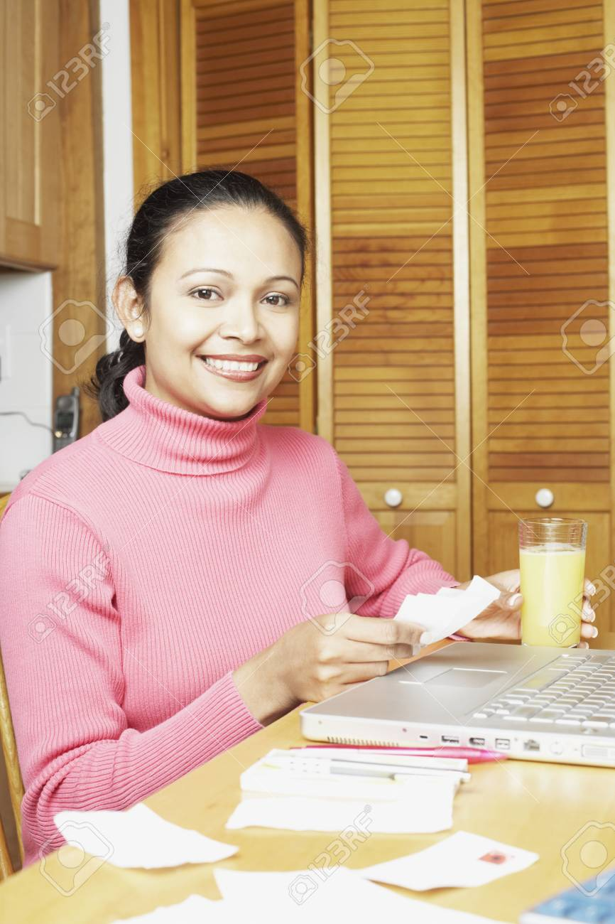 Young woman using a laptop Stock Photo - 16074667