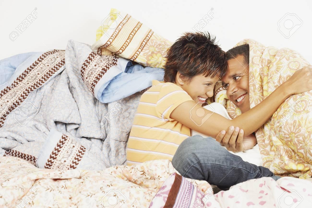 Young couple relaxing among blankets Stock Photo - 16074686