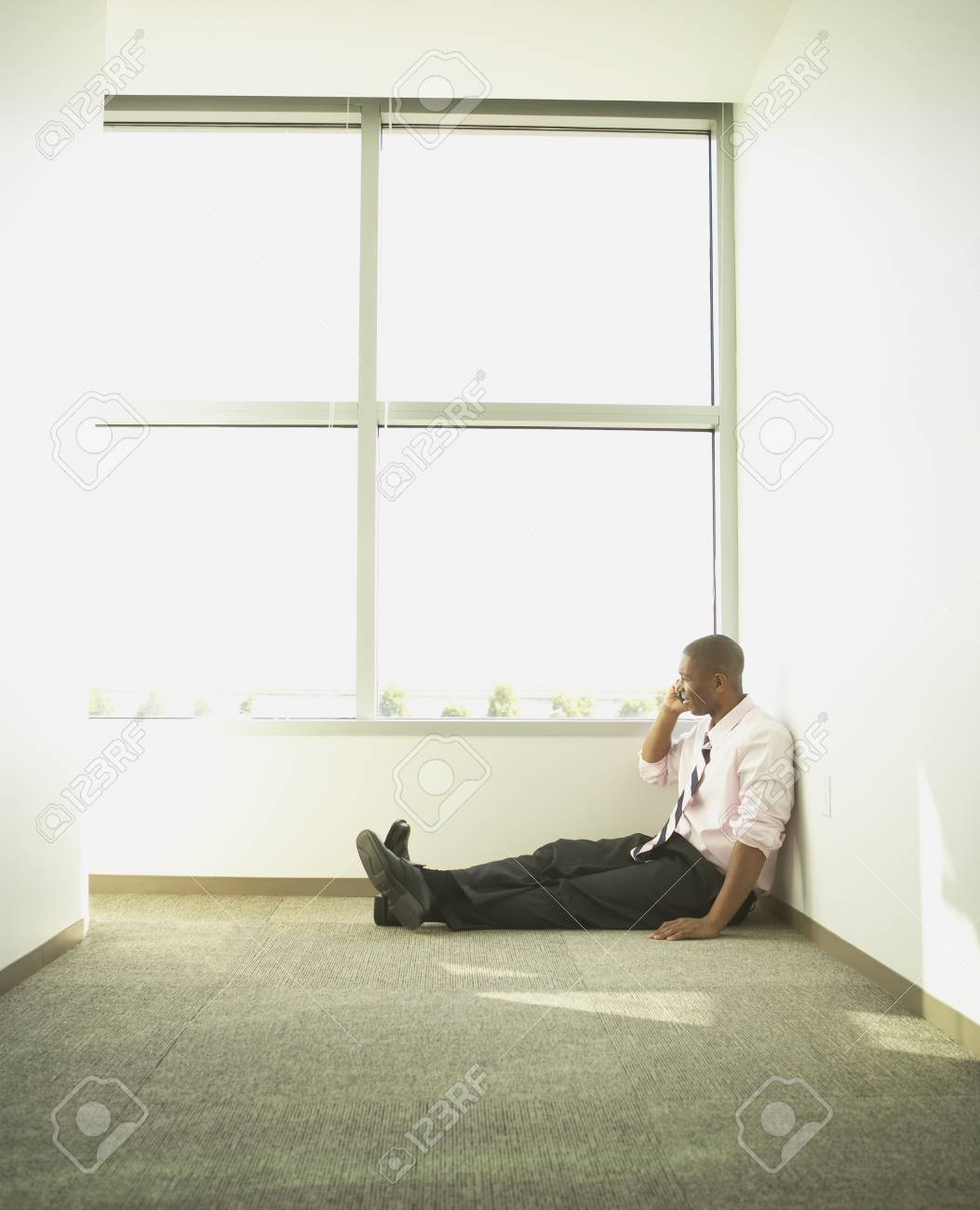 Businessman talking on his cell phone in the hall Stock Photo - 16089293