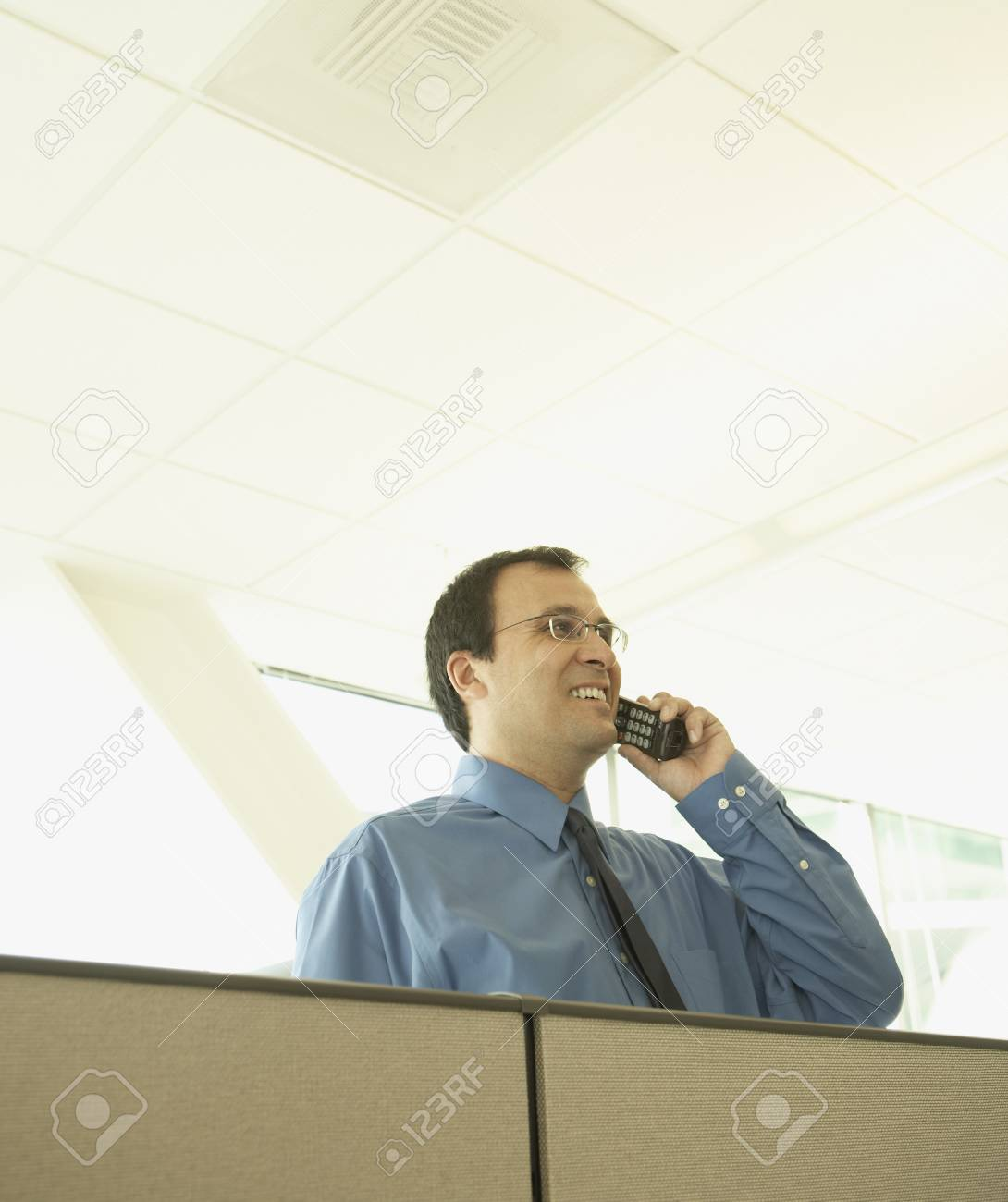 Businessman talking on the phone over partition Stock Photo - 16089304