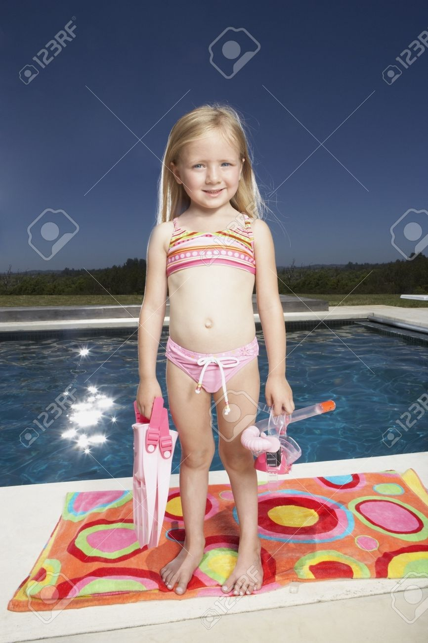 youngster girls bathing costume child: Young girl holding scuba gear LANG_EVOIMAGES
