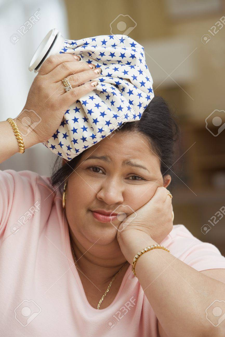Woman holding a cold compress on her head Stock Photo - 16089441