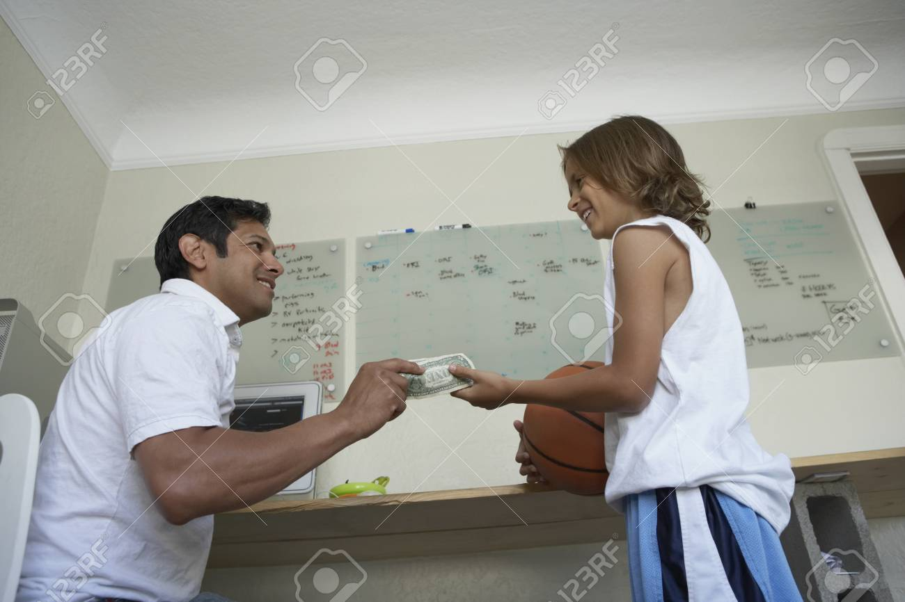 Father giving his son some money Stock Photo - 16070353