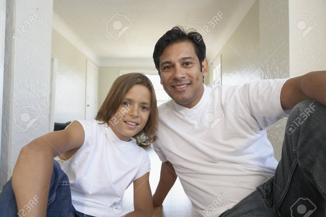 Father and son smiling for the camera Stock Photo - 16089684