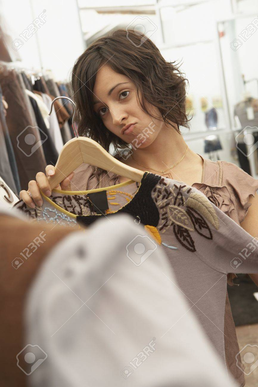 Young woman holding a dress against herself Stock Photo - 16089694