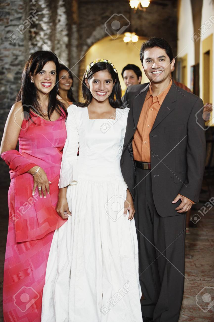 Family in evening wear smiling for the camera Stock Photo - 16089839
