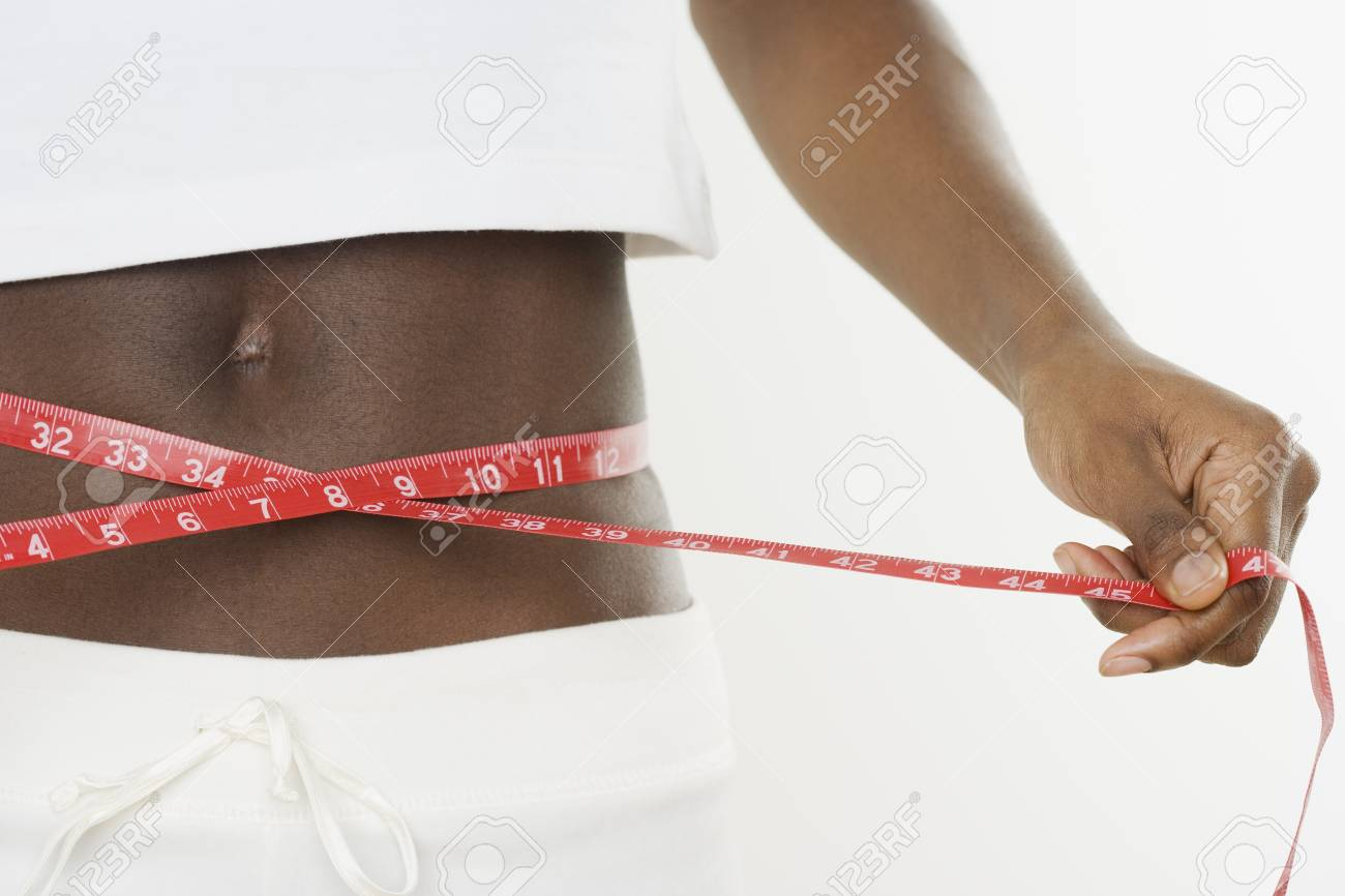 Young woman measuring her waist Stock Photo - 16090163