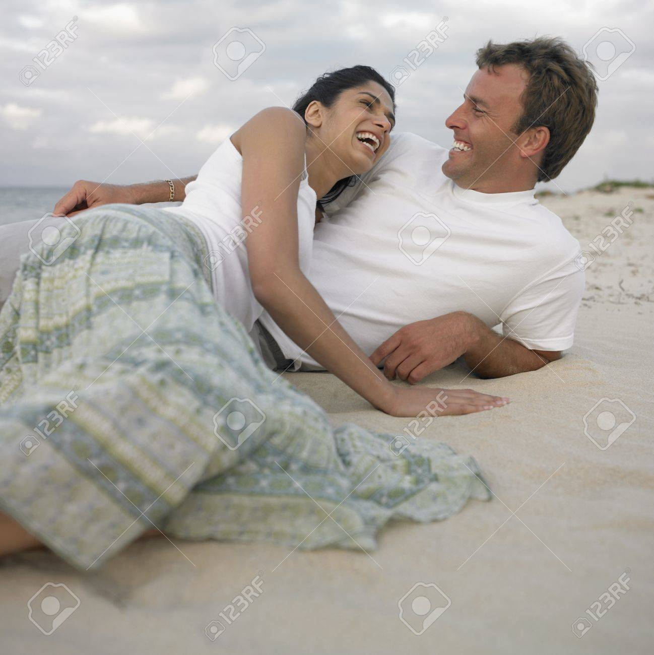 Couple lying on the beach, Busselton, Australia Stock Photo - 16090358