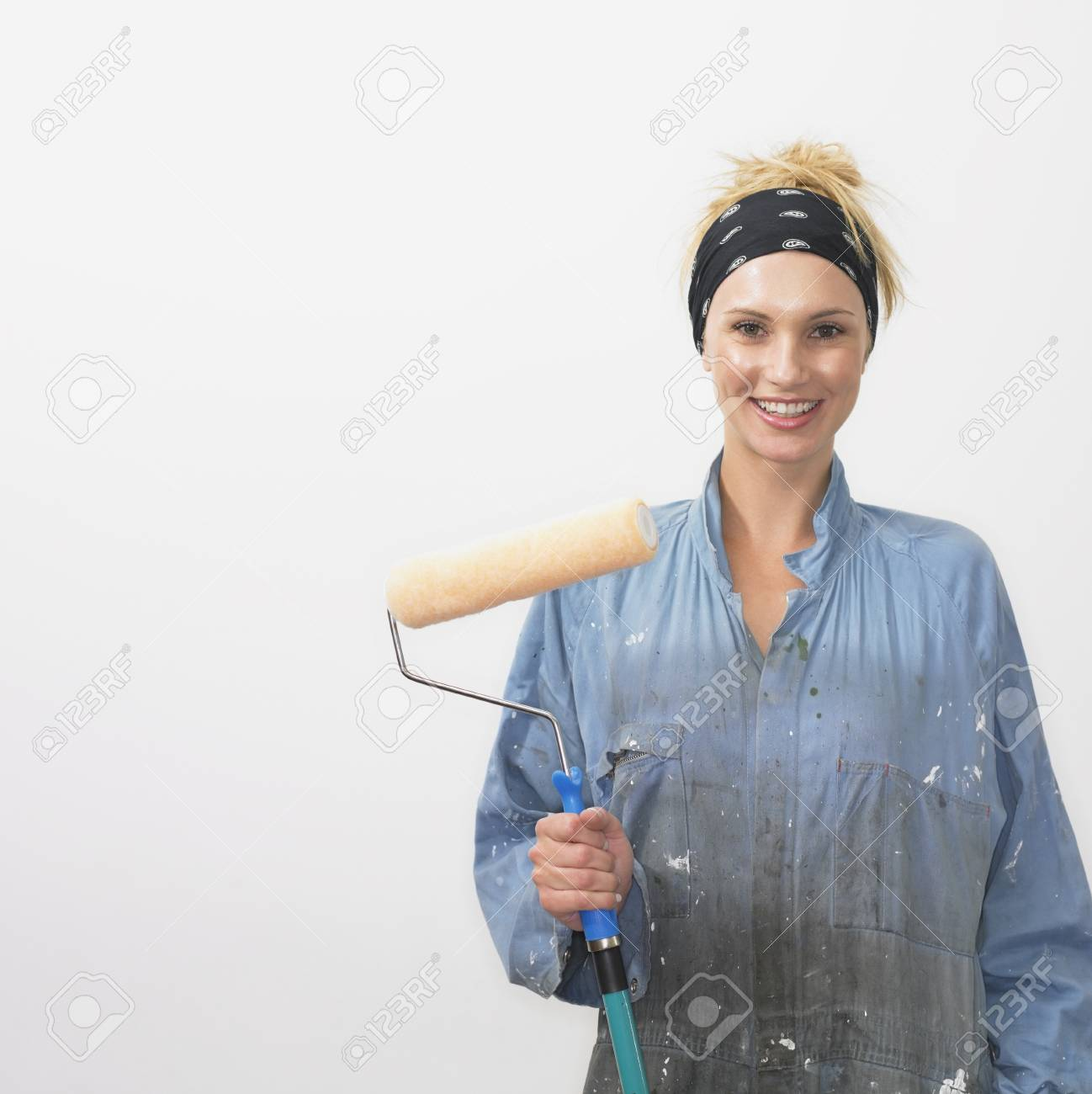 Woman with paint roller Stock Photo - 16090369