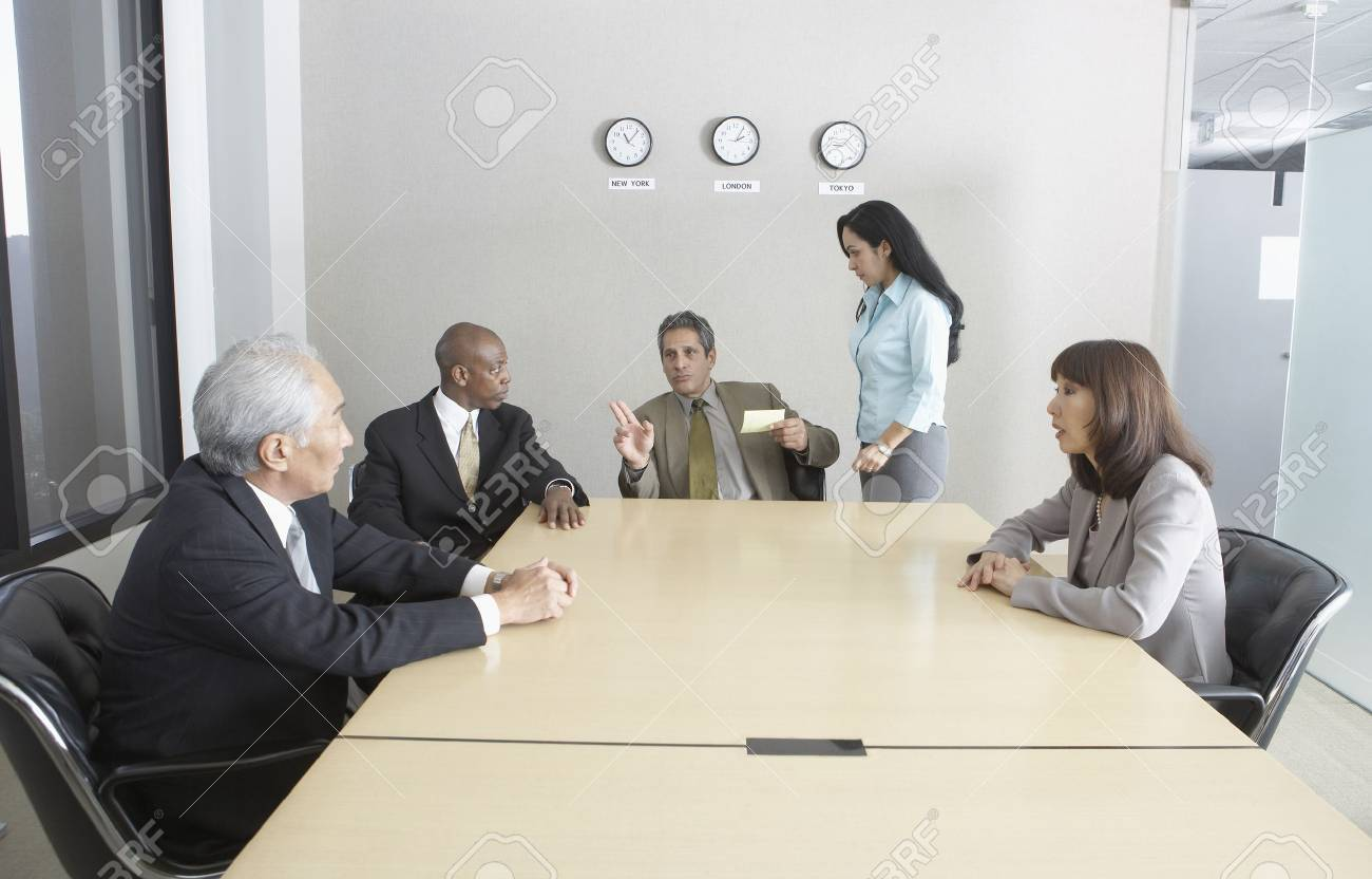 Businesspeople in a conference room Stock Photo - 16090444