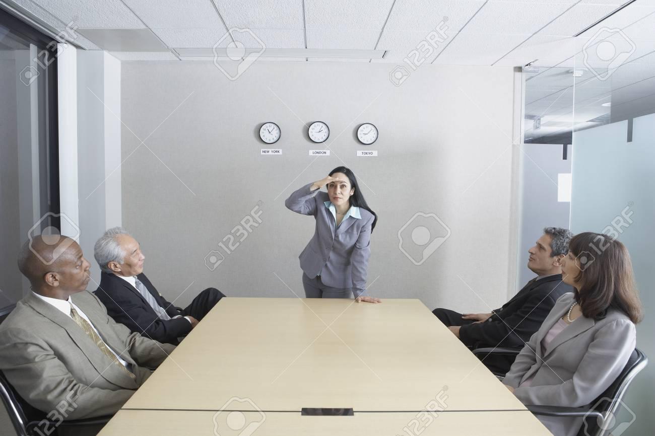 Hispanic woman presiding over meeting Stock Photo - 16090453