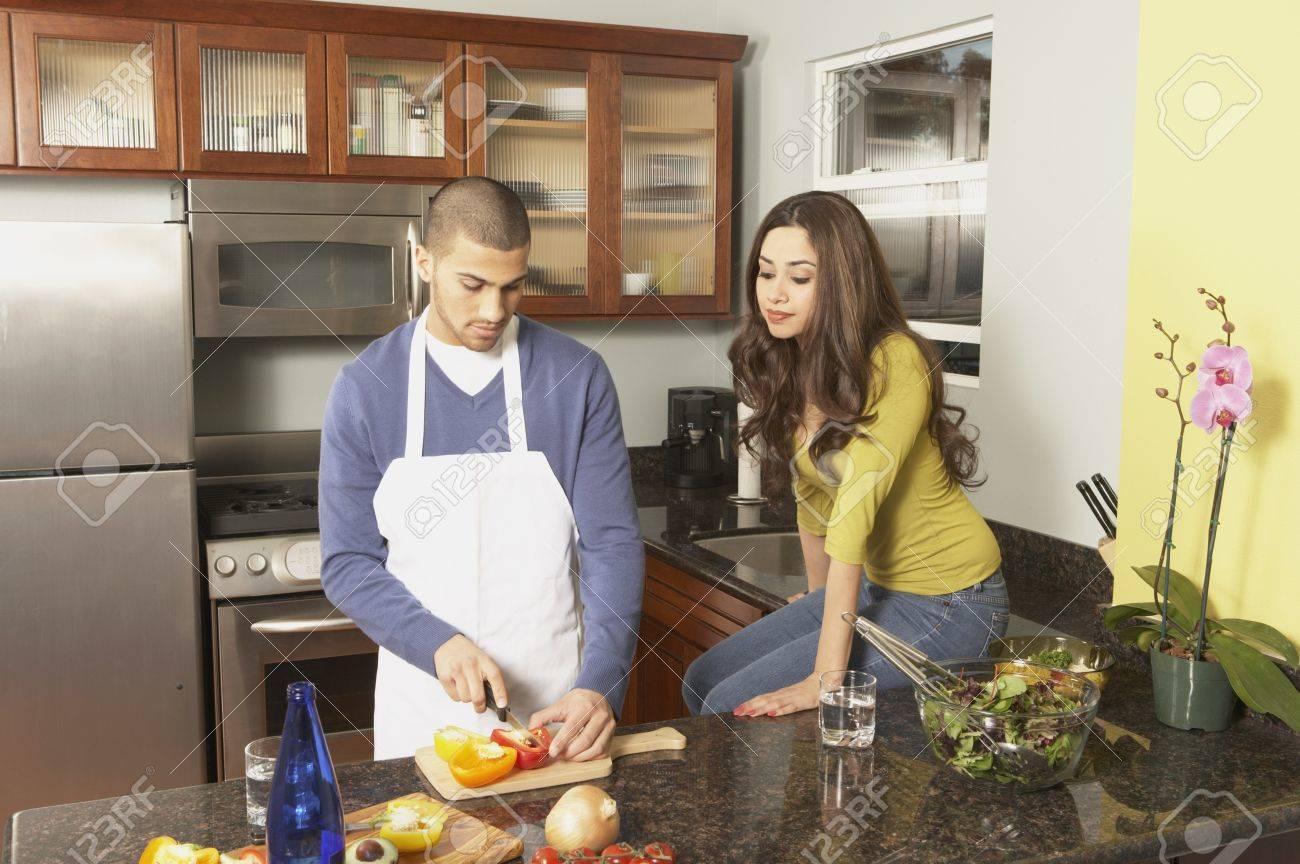 Young Hispanic couple chopping vegetables, San Rafael, California, United States Stock Photo - 16090715