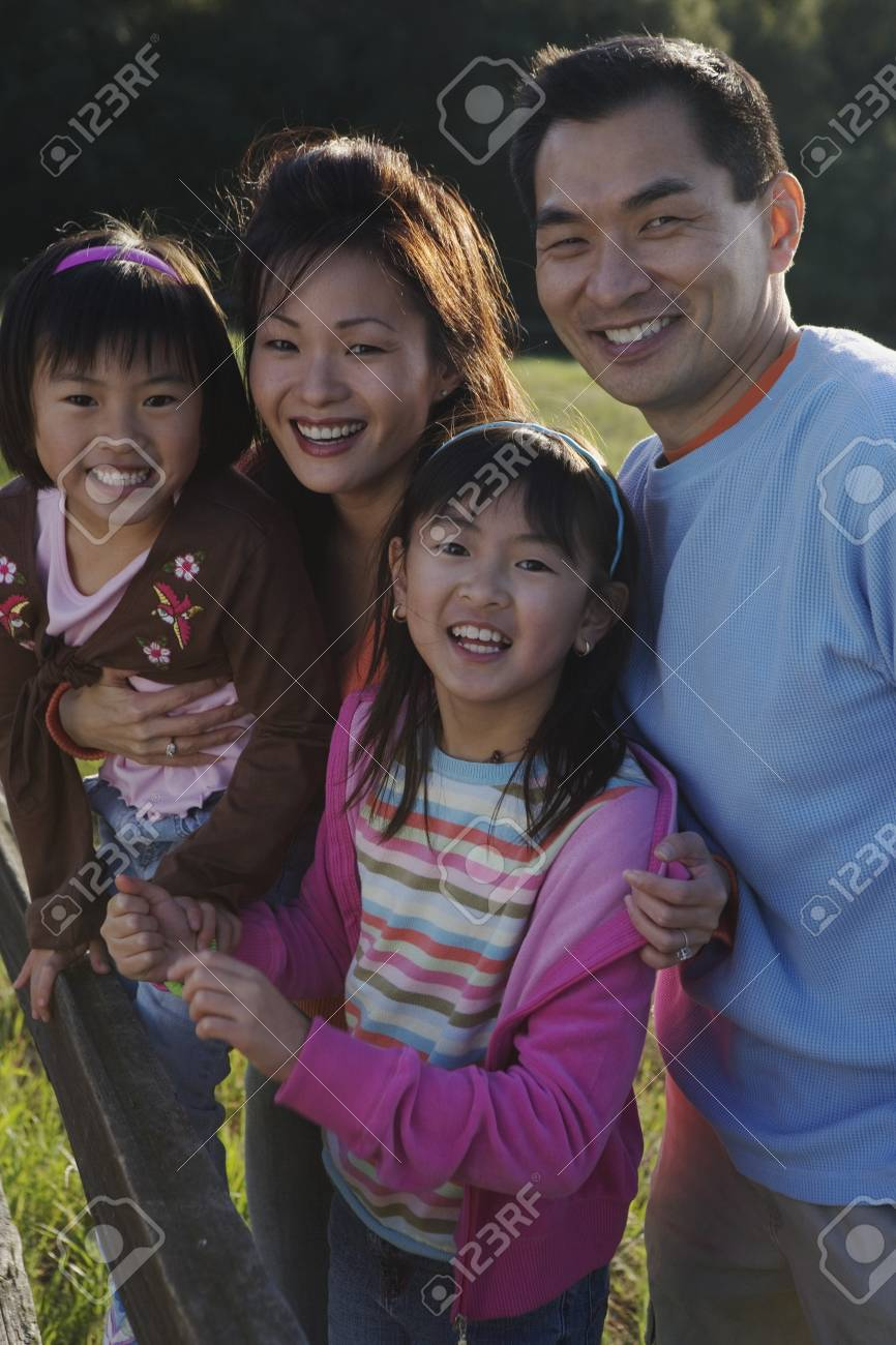 Asian family smiling in the countryside Stock Photo - 16090927