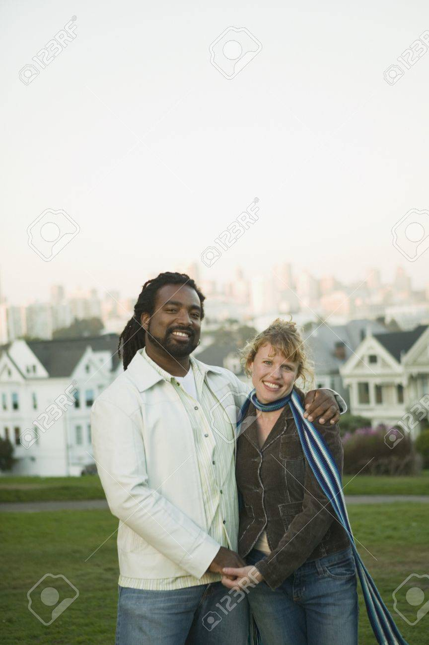 Couple posing for the camera outdoors Stock Photo - 16091188