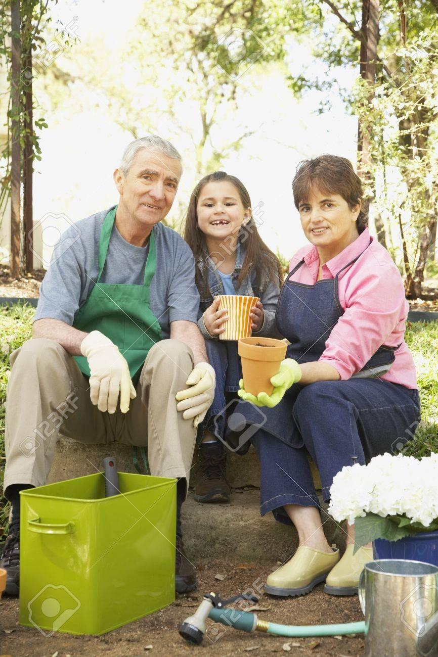 Hispanic grandparents and granddaughter gardening Stock Photo - 16091298