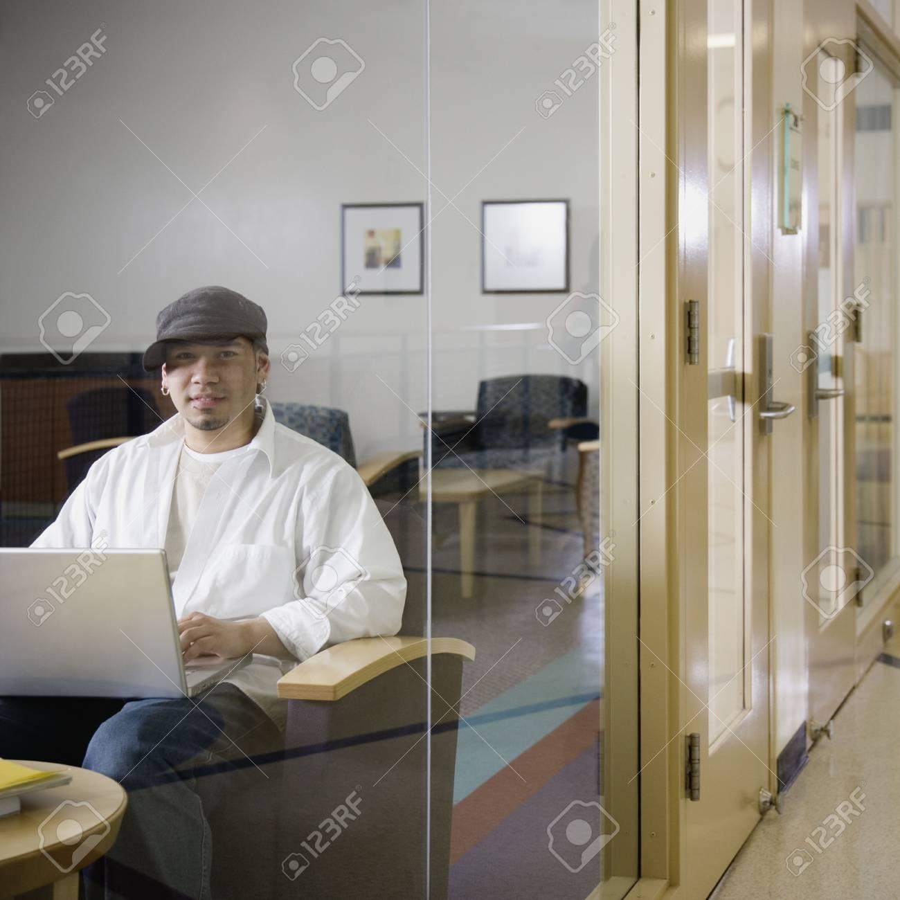 Young man using laptop Stock Photo - 16091444