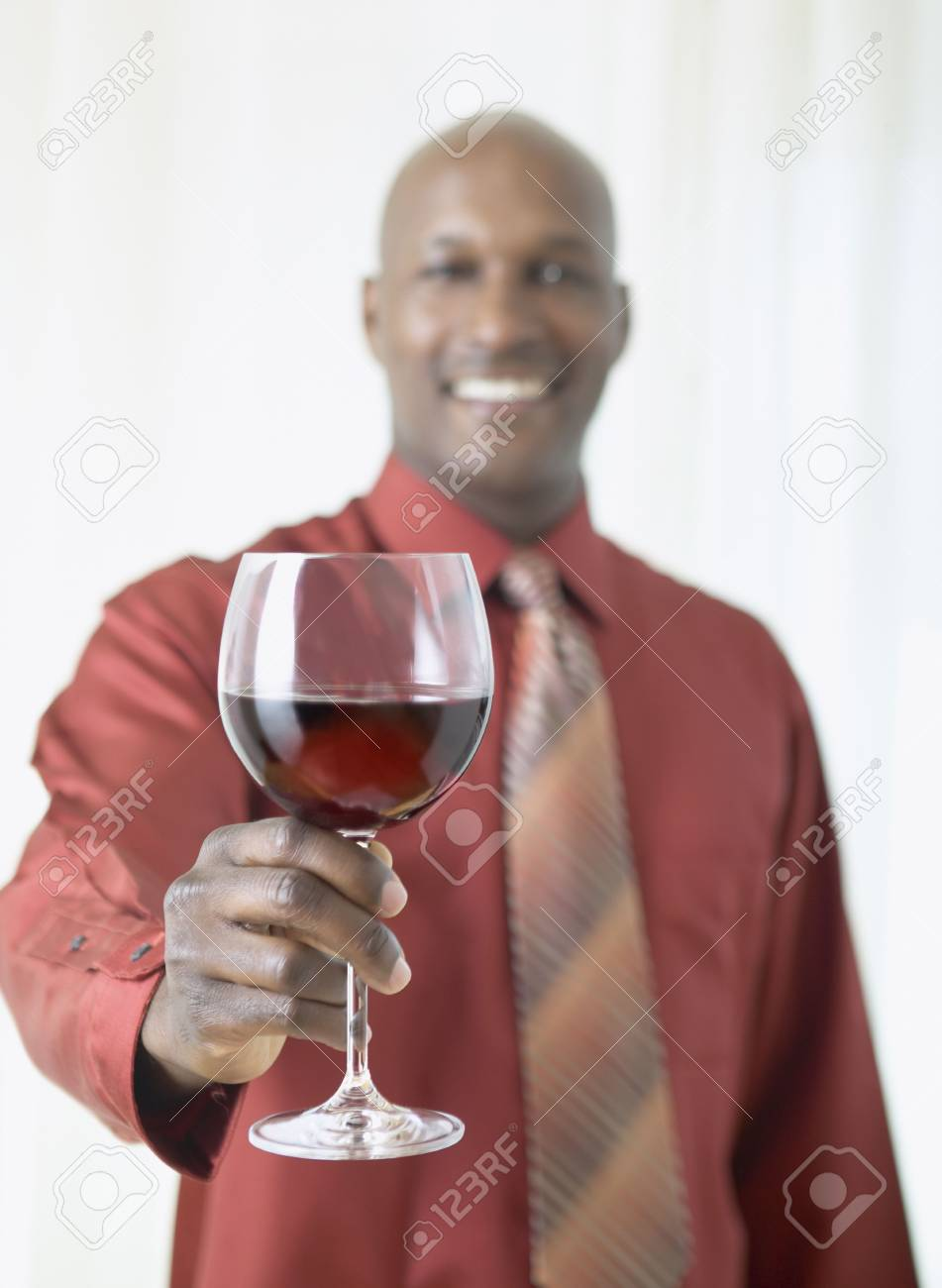 African man holding glass of red wine Stock Photo - 16091579