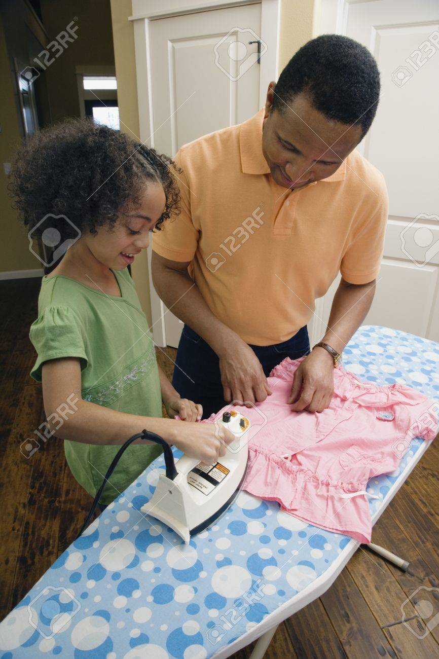 African father and daughter ironing Stock Photo - 16091728