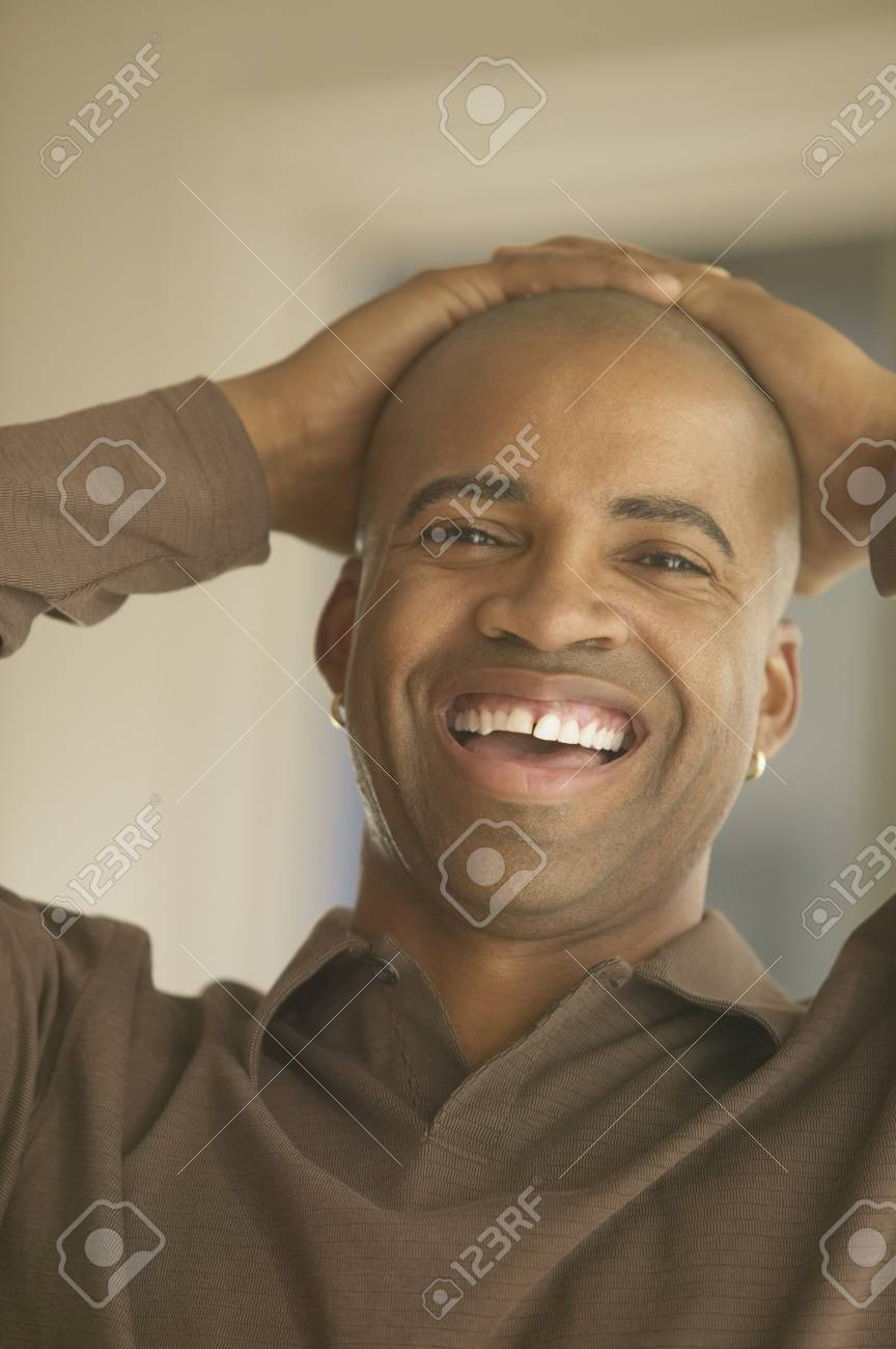 Close up of African man laughing with hands on head Stock Photo - 16092011