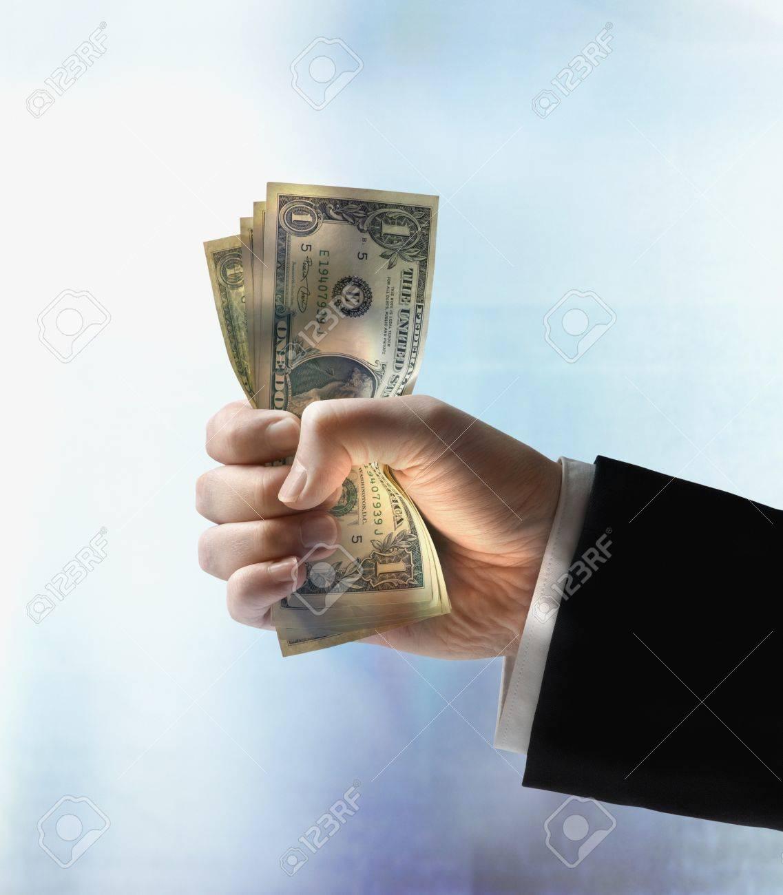 Businessman's hand holding US dollars Stock Photo - 16092031