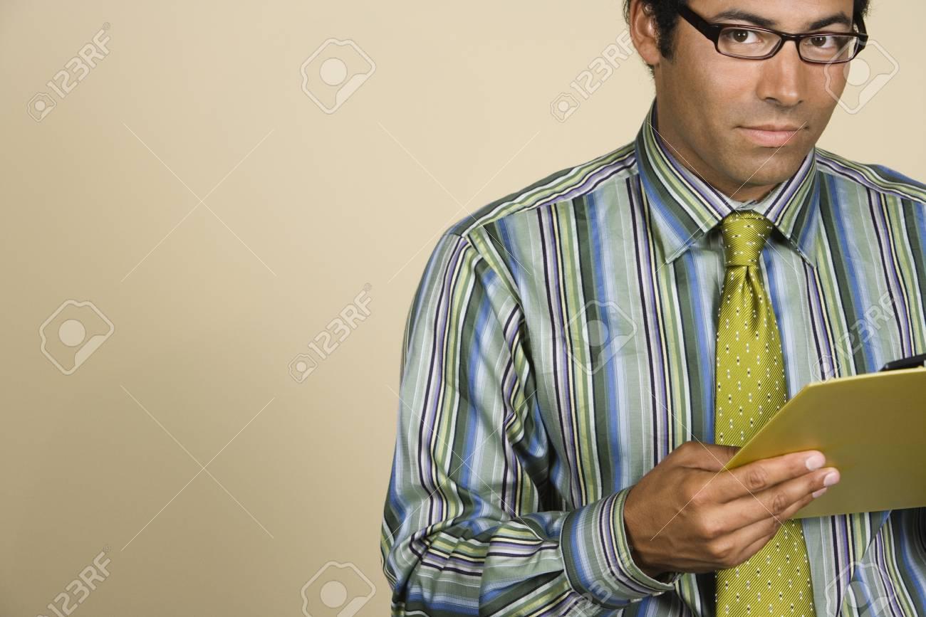 Native American businessman holding clipboard Stock Photo - 16092442