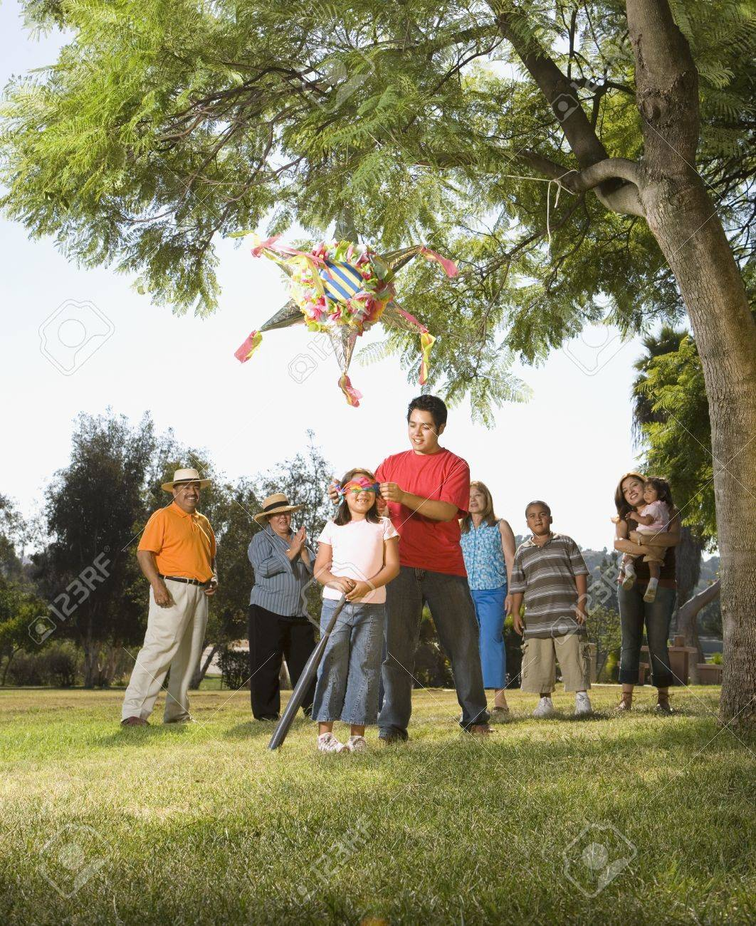 Hispanic girl being blindfolded next to pinata Stock Photo - 16092743