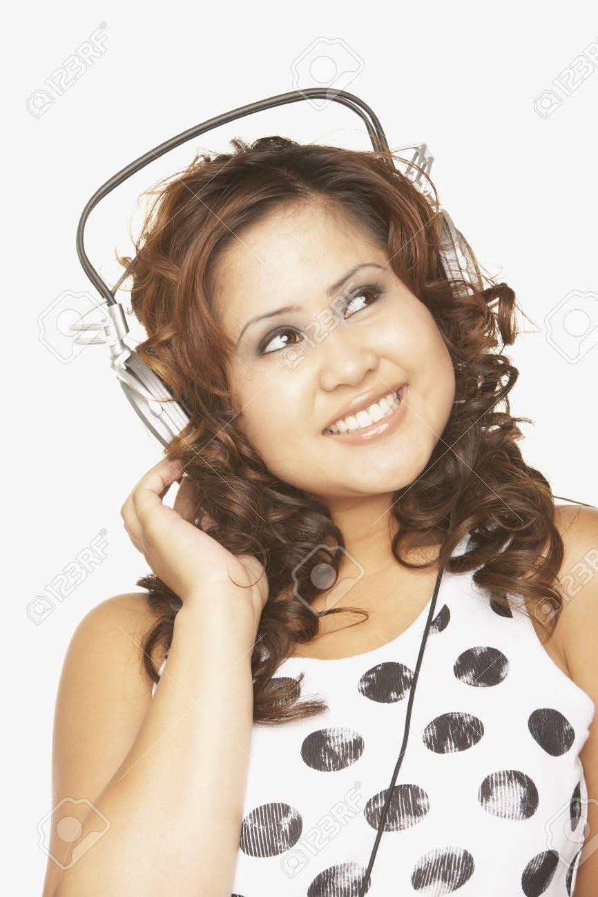 Asian woman listening to headphones Stock Photo - 16092783