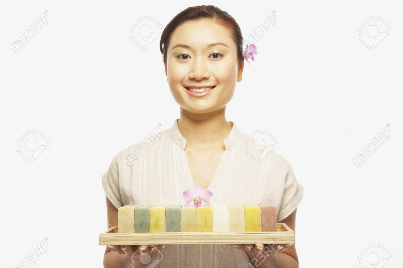 Asian woman holding tray of soap Stock Photo - 16092868