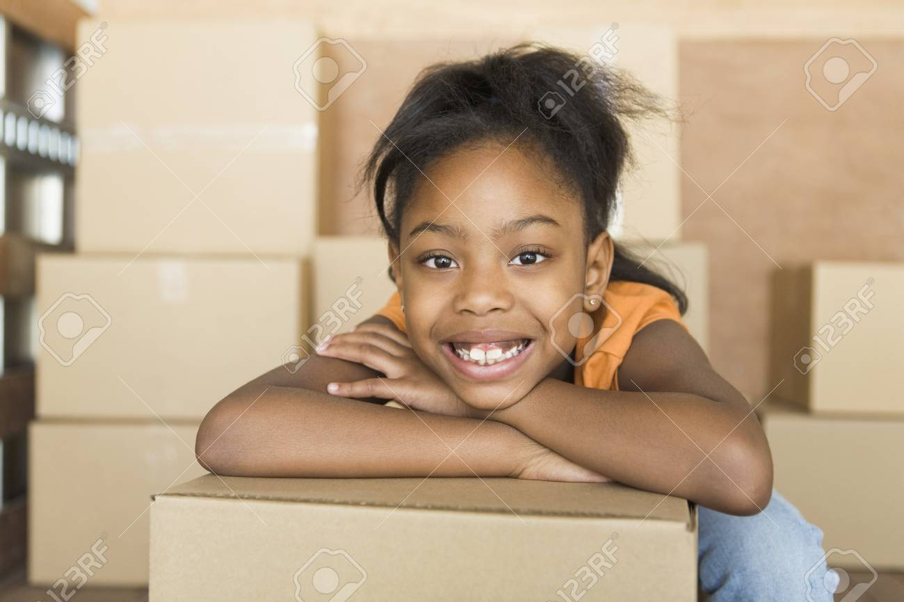 African girl leaning on moving boxes Stock Photo - 16093320