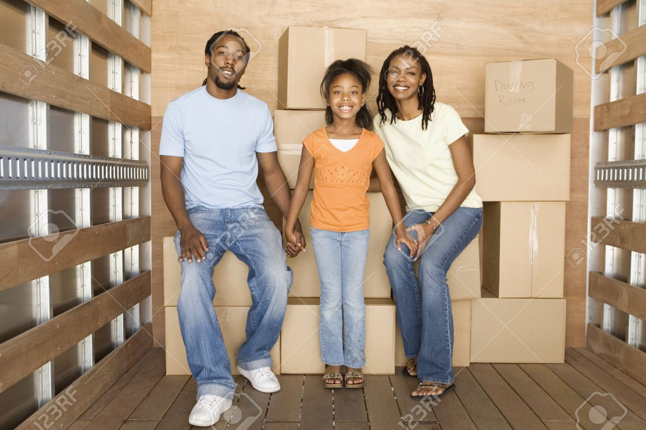 African family in back of moving truck Stock Photo - 16093323