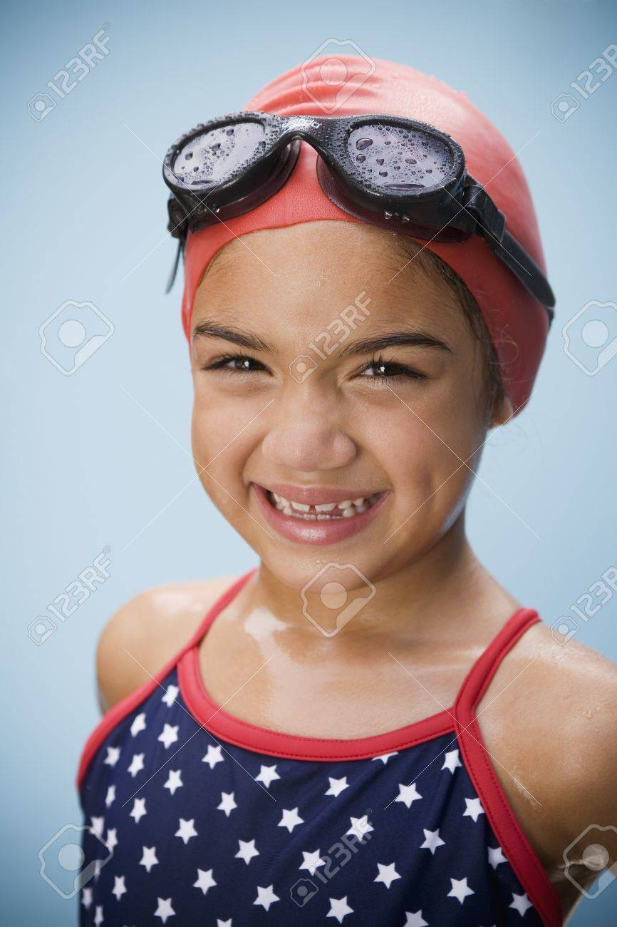 Hispanic girl in bathing suit with goggles and swim cap Stock Photo - 16093356