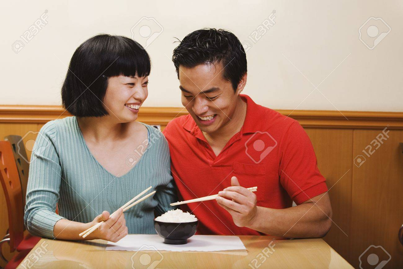 16093596 Asian couple eating rice Stock Photo