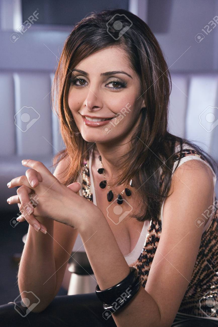 Portrait of Middle Eastern woman with hands clasped Stock Photo - 16094582
