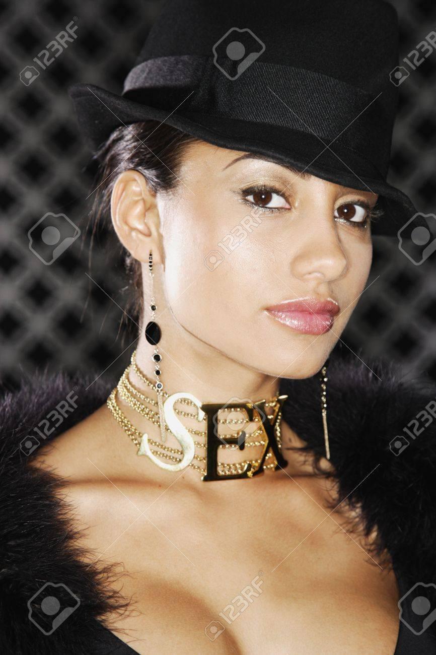 Portrait of Hispanic woman wearing SEX necklace Stock Photo - 16094594