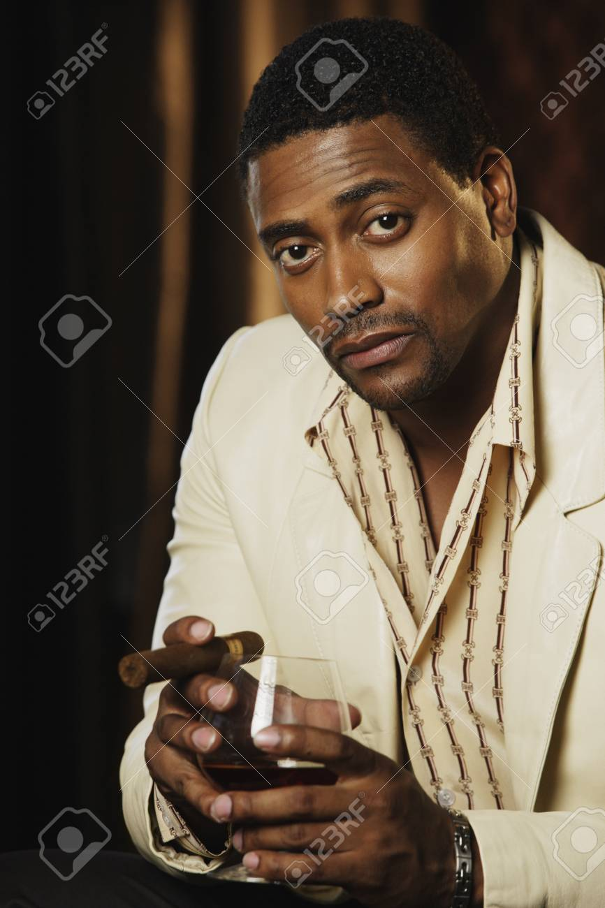 Portrait of African man holding drink and cigar Stock Photo - 16094599