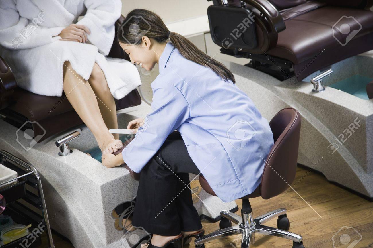Asian Nail Technician Filing Client\'s Toenails Stock Photo, Picture ...