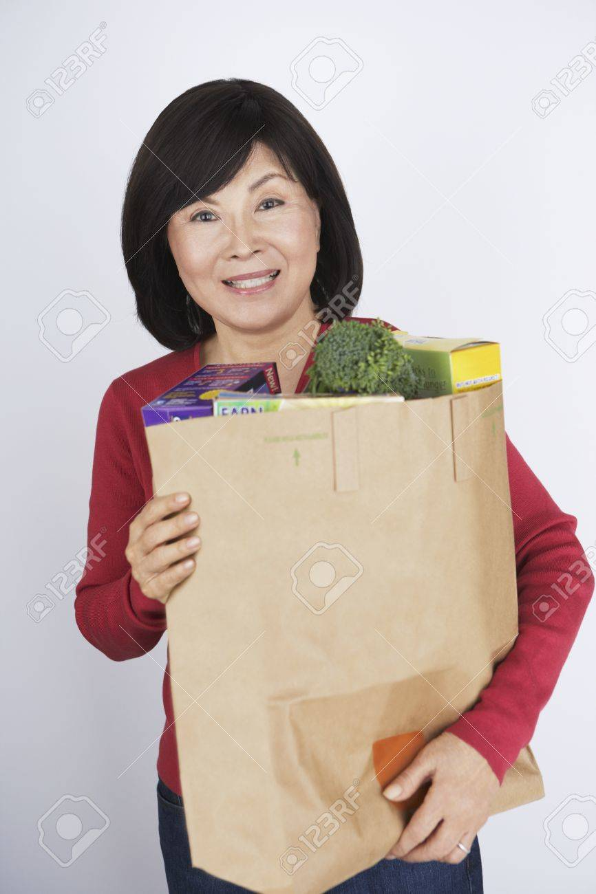 Senior Asian woman carrying grocery bag Stock Photo - 16094745