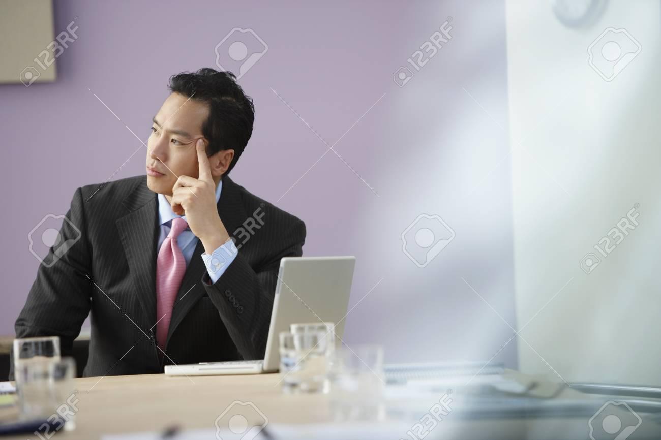 Asian businessman thinking Stock Photo - 16094774