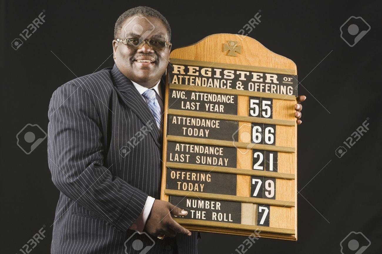 African man holding hymn board Stock Photo - 16094920