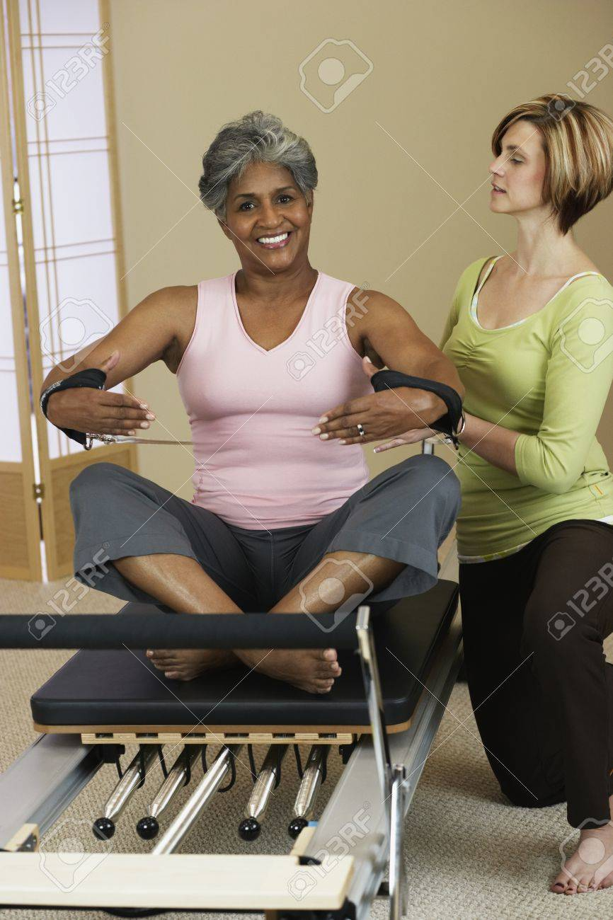 African woman exercising with personal trainer Stock Photo - 16094923