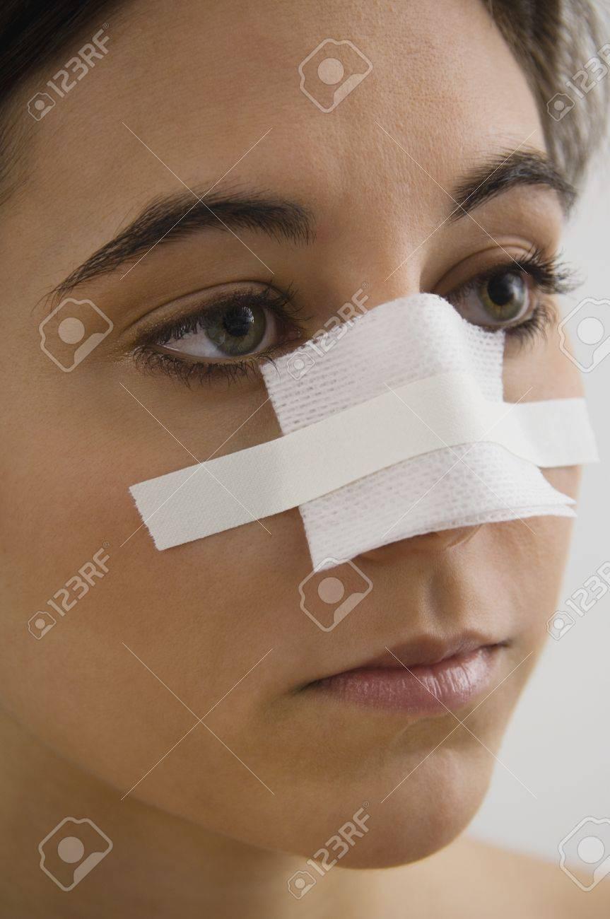 native american w bandage on nose stock photo picture native american w bandage on nose stock photo 16095018