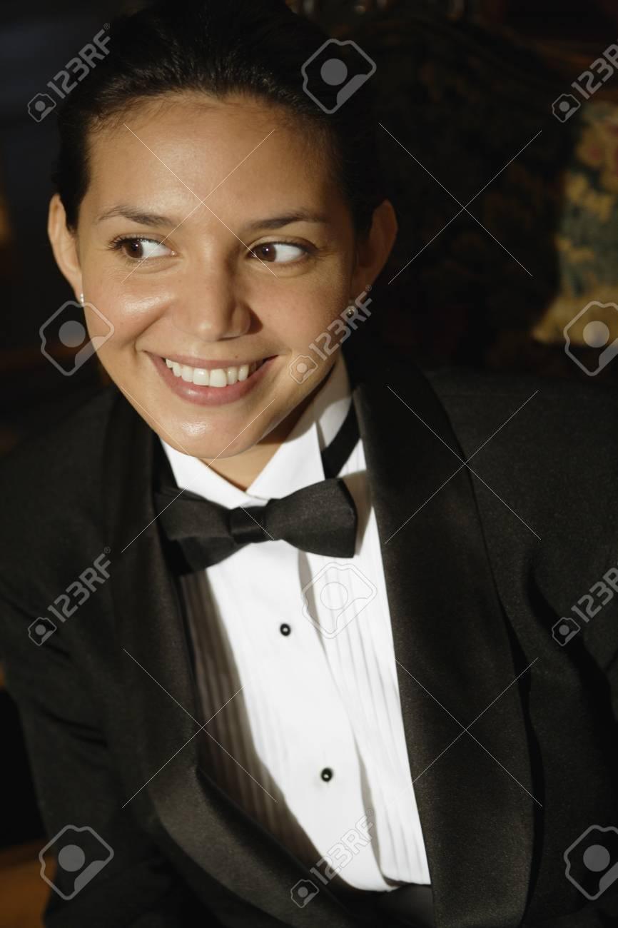 Hispanic female waiter in tuxedo Stock Photo - 16095029